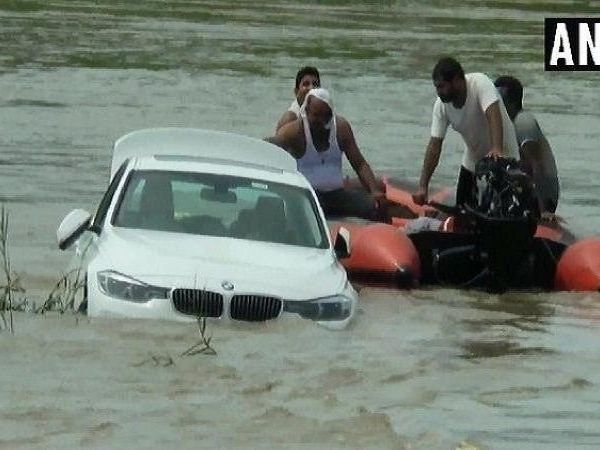 haryana bmw car in river