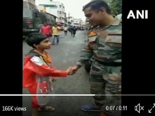 girl salute army man