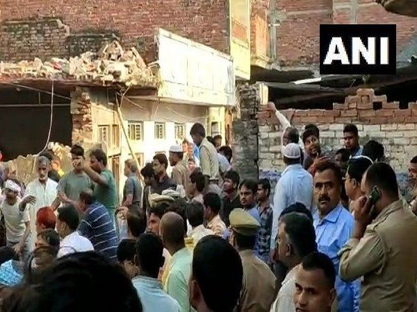 two storey building collapsed and 12 dead following a cylinder blast at a home in mau uttar pradesh